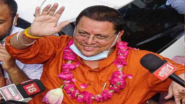 उत्तराखंड के नए CM की शपथ:45 साल के धामी राज्य के सबसे युवा मुख्यमंत्री बने, सतपाल समेत 11 मंत्रियों की पुरानी टीम ने भी शपथ ली